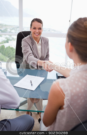 Business partners shaking hands stock photo, Business partners shaking hands after signing contract by Wavebreak Media