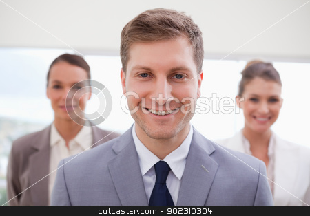 Sales manager standing stock photo, Sales manager standing with his team behind him by Wavebreak Media