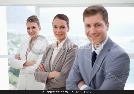 Department manager with his team stock photo, Department manager standing with his his team by Wavebreak Media