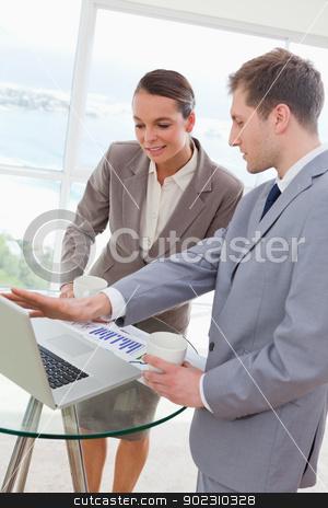 Market analyst talking with customer stock photo, Market analyst talking with customer about research results by Wavebreak Media