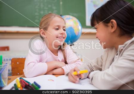 Happy schoolgirls drawing stock photo, Happy schoolgirls drawing in a classroom by Wavebreak Media
