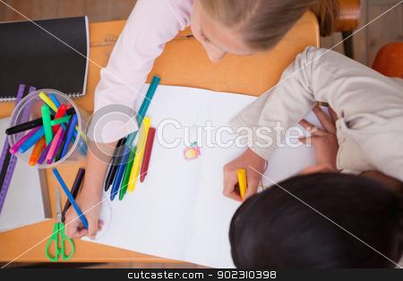 Above view of schoolgirls drawing stock photo, Above view of schoolgirls drawing in a classroom by Wavebreak Media