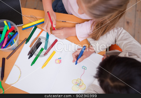 Above view of little schoolgirls drawing stock photo, Above view of little schoolgirls drawing in a classroom by Wavebreak Media