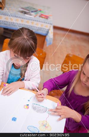 Portrait of a schoolgirls drawing stock photo, Portrait of a schoolgirls drawing in a classroom by Wavebreak Media