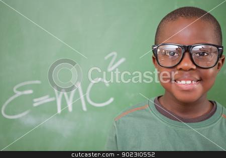Smart schoolboy posing stock photo, Smart schoolboy posing in front of a blackboard by Wavebreak Media