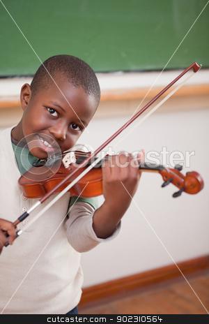 Portrait of a boy playing the violin stock photo, Portrait of a boy playing the violin in a classroom by Wavebreak Media
