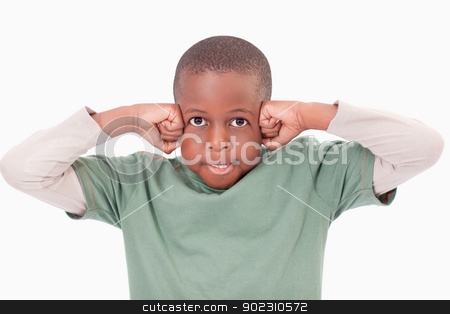 Boy with the fists on his face stock photo, Boy with the fists on his face against a white background by Wavebreak Media