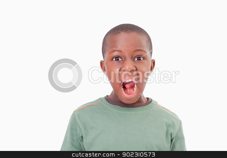 Boy with the mouth open stock photo, Boy with the mouth open against a white background by Wavebreak Media