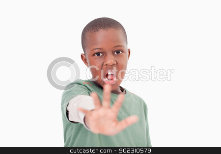 Boy saying stop with his hand stock photo, Boy saying stop with his hand against a white background by Wavebreak Media