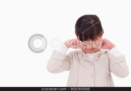 Little girl crying stock photo, Little girl crying against a white background by Wavebreak Media