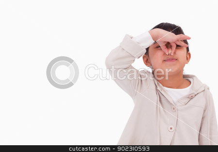 Girl pinching her nose stock photo, Girl pinching her nose against a white background by Wavebreak Media