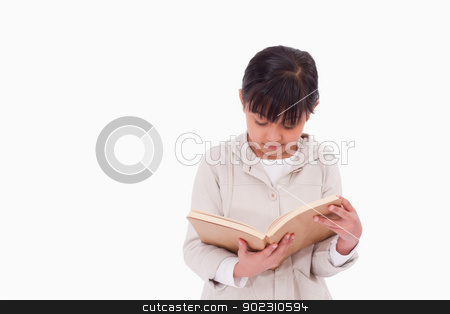 Girl reading a book stock photo, Girl reading a book against a white background by Wavebreak Media