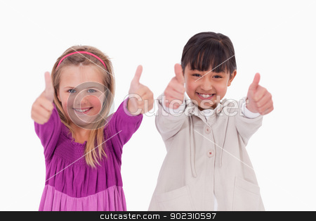 Girls with the thumbs up stock photo, Girls with the thumbs up against a white background by Wavebreak Media