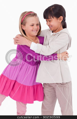 Portrait of girls hugging stock photo, Portrait of girls hugging against a white background by Wavebreak Media