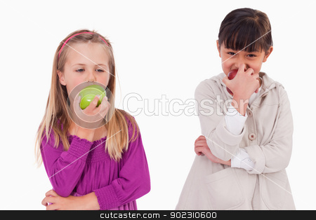 Girls eating apples stock photo, Girls eating apples against a white background by Wavebreak Media