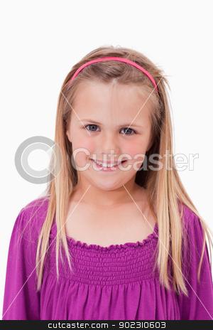 Portrait of a smiling girl stock photo, Portrait of a smiling girl against a white background by Wavebreak Media