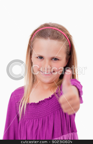 Portrait of a girl with the thumb up stock photo, Portrait of a girl with the thumb up against a white background by Wavebreak Media