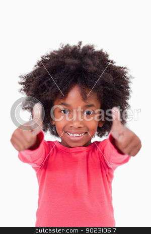 Portrait of a cute girl with the thumbs up stock photo, Portrait of a cute girl with the thumbs up against a white background by Wavebreak Media