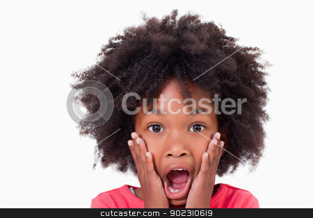 Close up of a shocked girl stock photo, Close up of a shocked girl against a white background by Wavebreak Media
