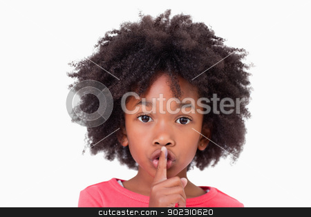 Close up of a girl asking silence stock photo, Close up of a girl asking silence against a white background by Wavebreak Media