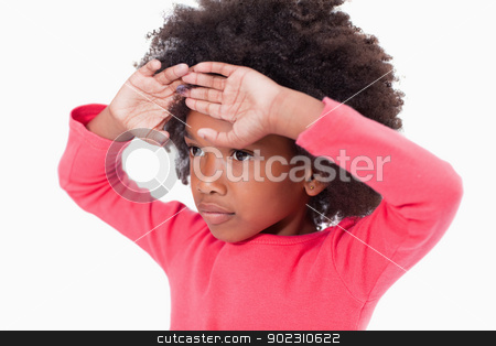 Girl with her hands on her forehead stock photo, Girl with her hands on her forehead against a white background by Wavebreak Media