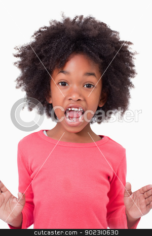 Portrait of a girl screaming stock photo, Portrait of a girl screaming against a white background by Wavebreak Media