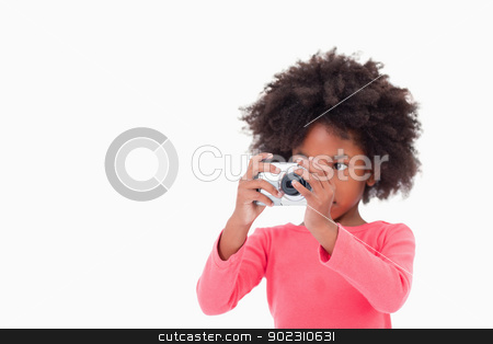 Girl taking a picture stock photo, Girl taking a picture against a white background by Wavebreak Media