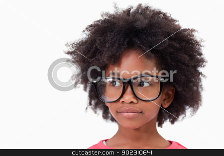 Close up of a smart girl stock photo, Close up of a smart girl against a white background by Wavebreak Media