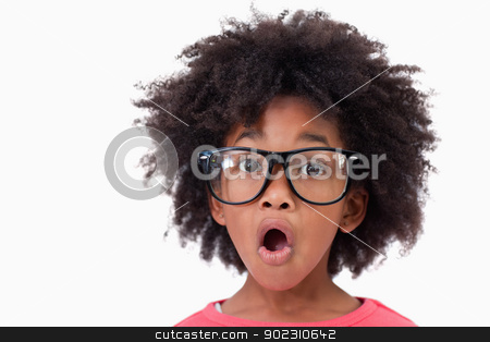 Close up of a shocked smart girl stock photo, Close up of a shocked smart girl against a white background by Wavebreak Media