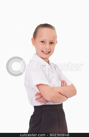 Portrait of a serious girl with the arms crossed stock photo, Portrait of a serious girl with the arms crossed against a white background by Wavebreak Media