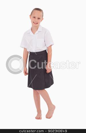 Portrait of a little girl posing stock photo, Portrait of a little girl posing against a white background by Wavebreak Media