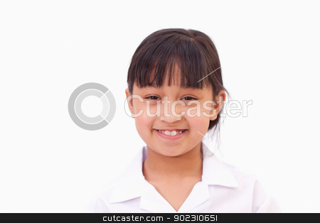 Cute little girl smiling stock photo, Cute little girl smiling against a white background by Wavebreak Media