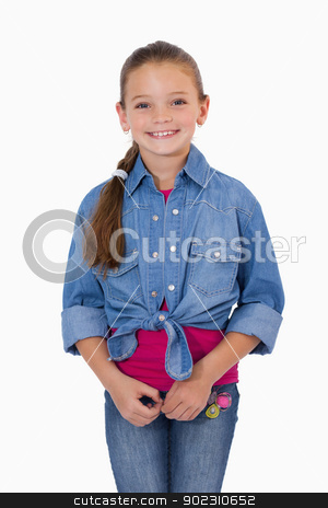 Portrait of a girl standing up stock photo, Portrait of a girl standing up against a white background by Wavebreak Media