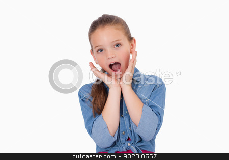 Shocked girl screaming stock photo, Shocked girl screaming against a white background by Wavebreak Media