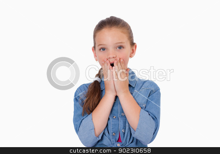 Girl being afraid by something stock photo, Girl being afraid by something against a white background by Wavebreak Media