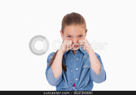 Lonely girl crying stock photo, Lonely girl crying against a white background by Wavebreak Media