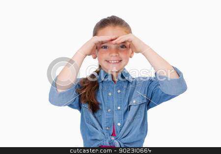 Smiling girl looking ahead stock photo, Smiling girl looking ahead against a white background by Wavebreak Media