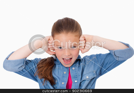 Girl with the fists on her face stock photo, Girl with the fists on her face against a white background by Wavebreak Media