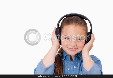 Girl listening to music stock photo, Girl listening to music against a white background by Wavebreak Media