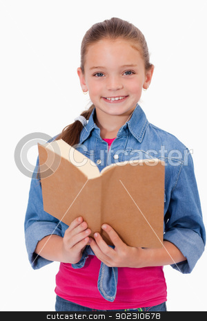 Portrait of a smart girl reading a book stock photo, Portrait of a smart girl reading a book against a white background by Wavebreak Media