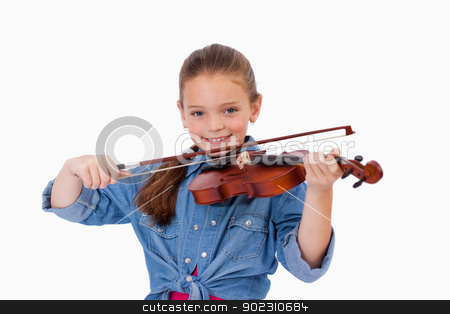 Girl playing the violin stock photo, Girl playing the violin against a white background by Wavebreak Media