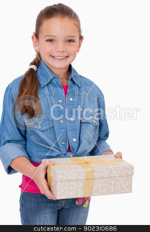 Portrait of a girl holding a gift box stock photo, Portrait of a girl holding a gift box against a white background by Wavebreak Media