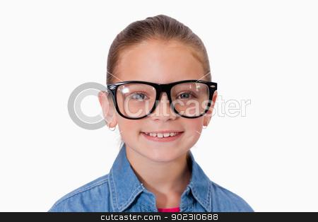 Girl wearing glasses stock photo, Girl wearing glasses against a white background by Wavebreak Media