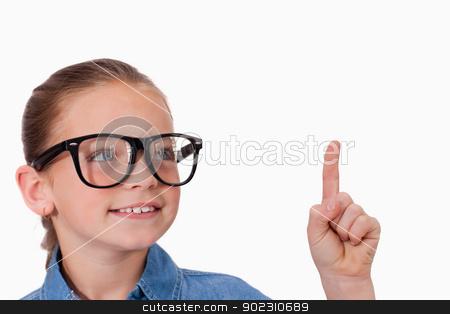Girl pointing at something stock photo, Girl pointing at something against a white background by Wavebreak Media