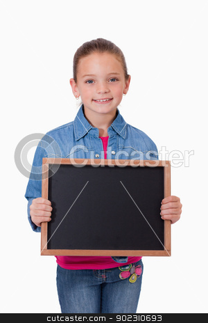 Portrait of a young girl holding a school slate stock photo, Portrait of a young girl holding a school slate against a white background by Wavebreak Media