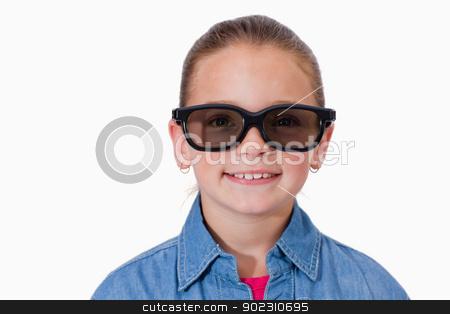 Girl wearing sunglasses stock photo, Girl wearing sunglasses against a white background by Wavebreak Media