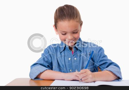 Little girl writing stock photo, Little girl writing against a white background by Wavebreak Media