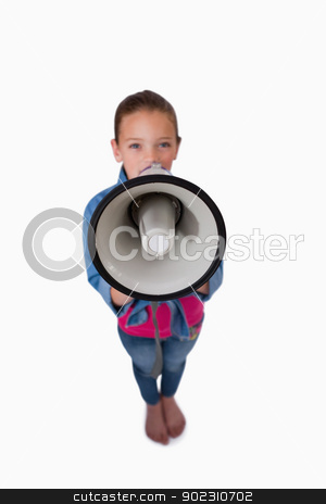 Portrait of a girl speaking through a megaphone stock photo, Portrait of a girl speaking through a megaphone against a white background by Wavebreak Media