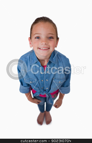 Portrait of a girl looking up stock photo, Portrait of a girl looking up against a white background by Wavebreak Media