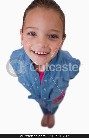 Portrait of a girl smiling at the camera stock photo, Portrait of a girl smiling at the camera against a white background by Wavebreak Media